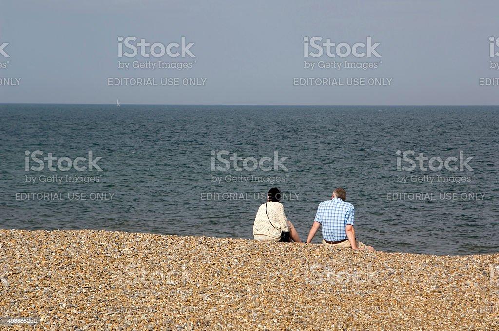 Couple on beach, England stock photo