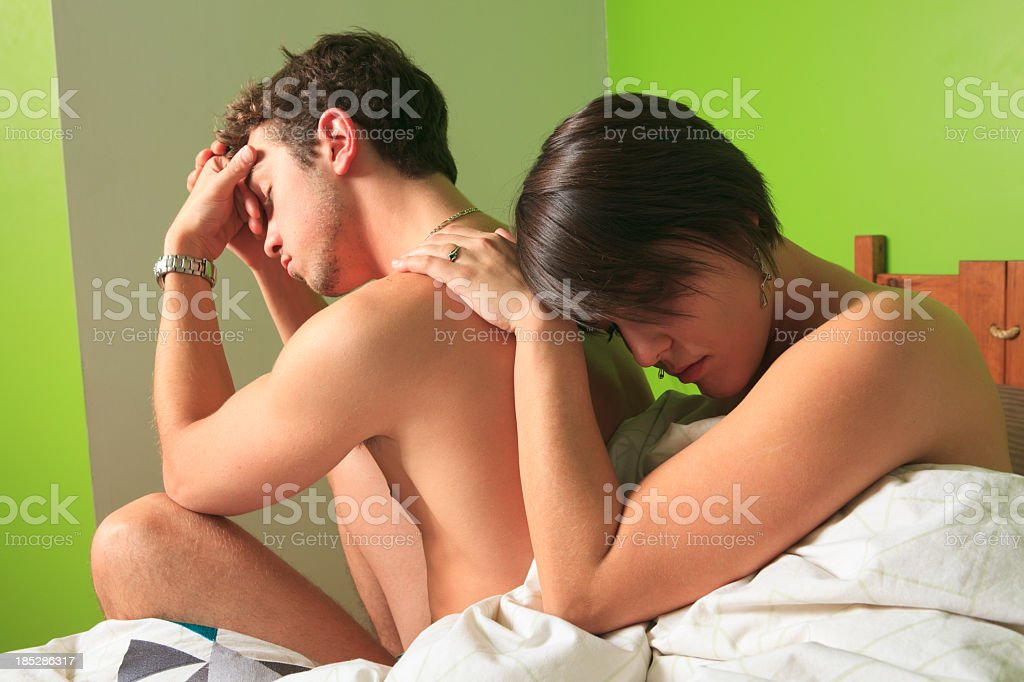Couple on Bed - Hard Situation royalty-free stock photo