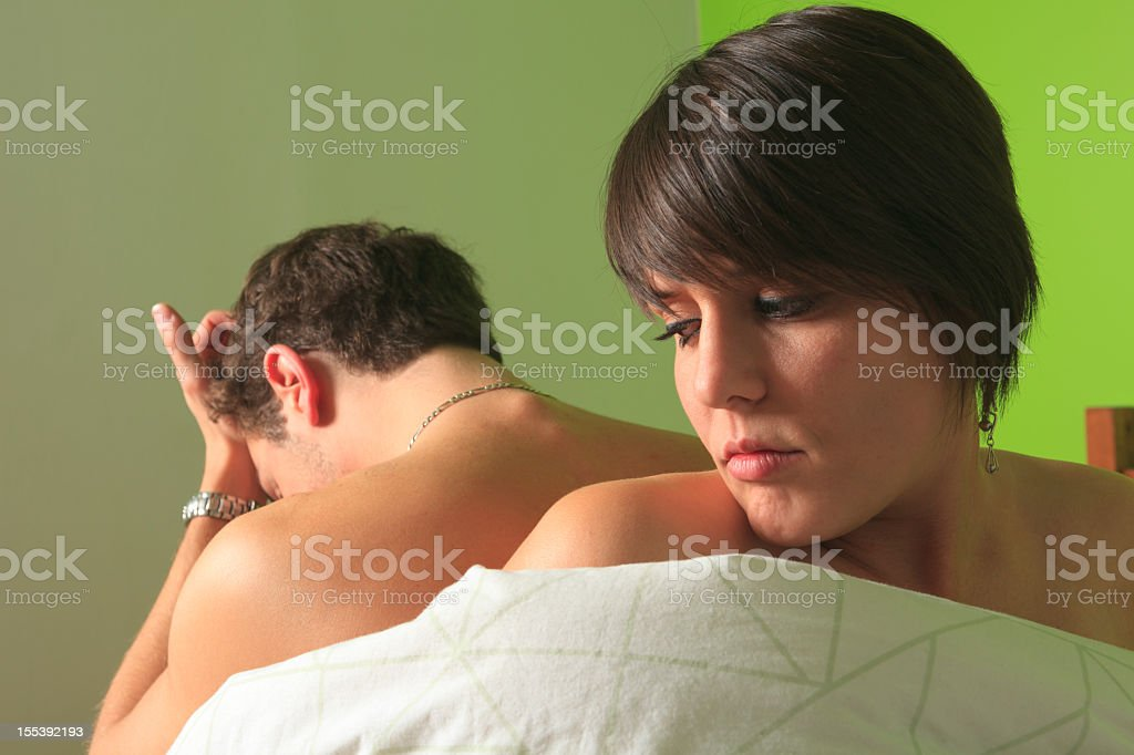 Couple on Bed - Mental Disorder stock photo