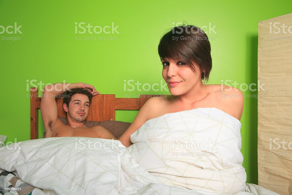 Couple on Bed - Satisfaction stock photo