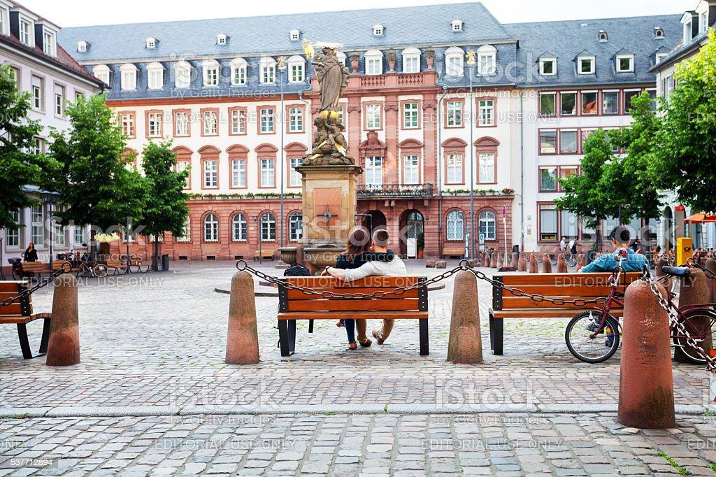 Couple on bench at square Karlsplatz stock photo