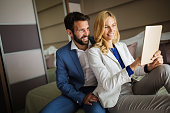 Couple on business trip using tablet