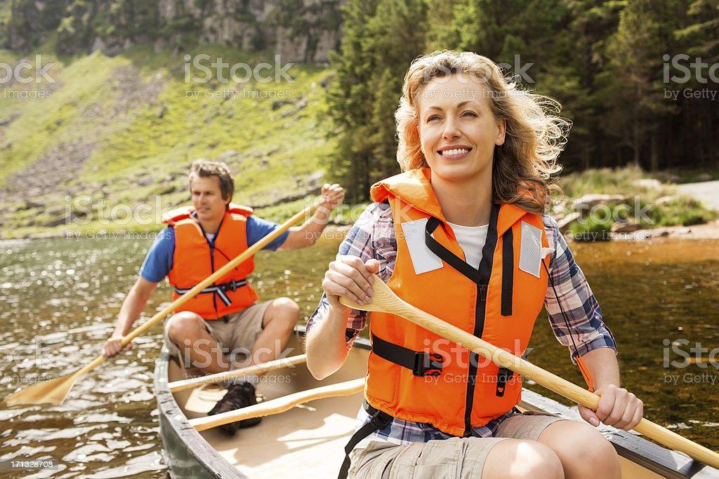Couple On Canoe Trip royalty-free stock photo