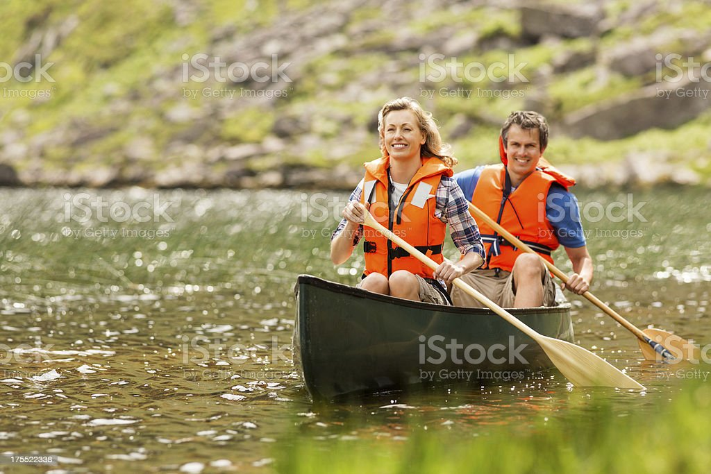 Couple On Canoe Trip stock photo