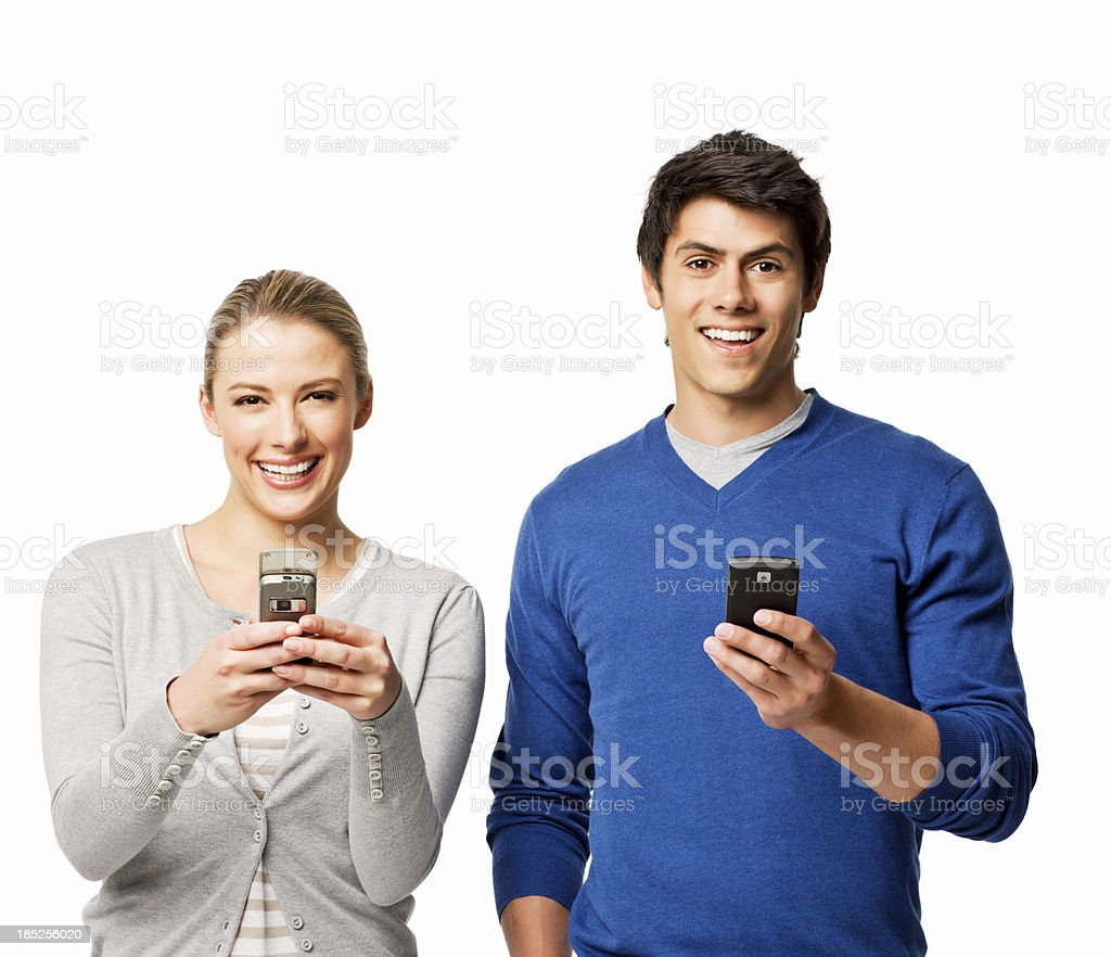 Couple on Cell Phones - Isolated royalty-free stock photo