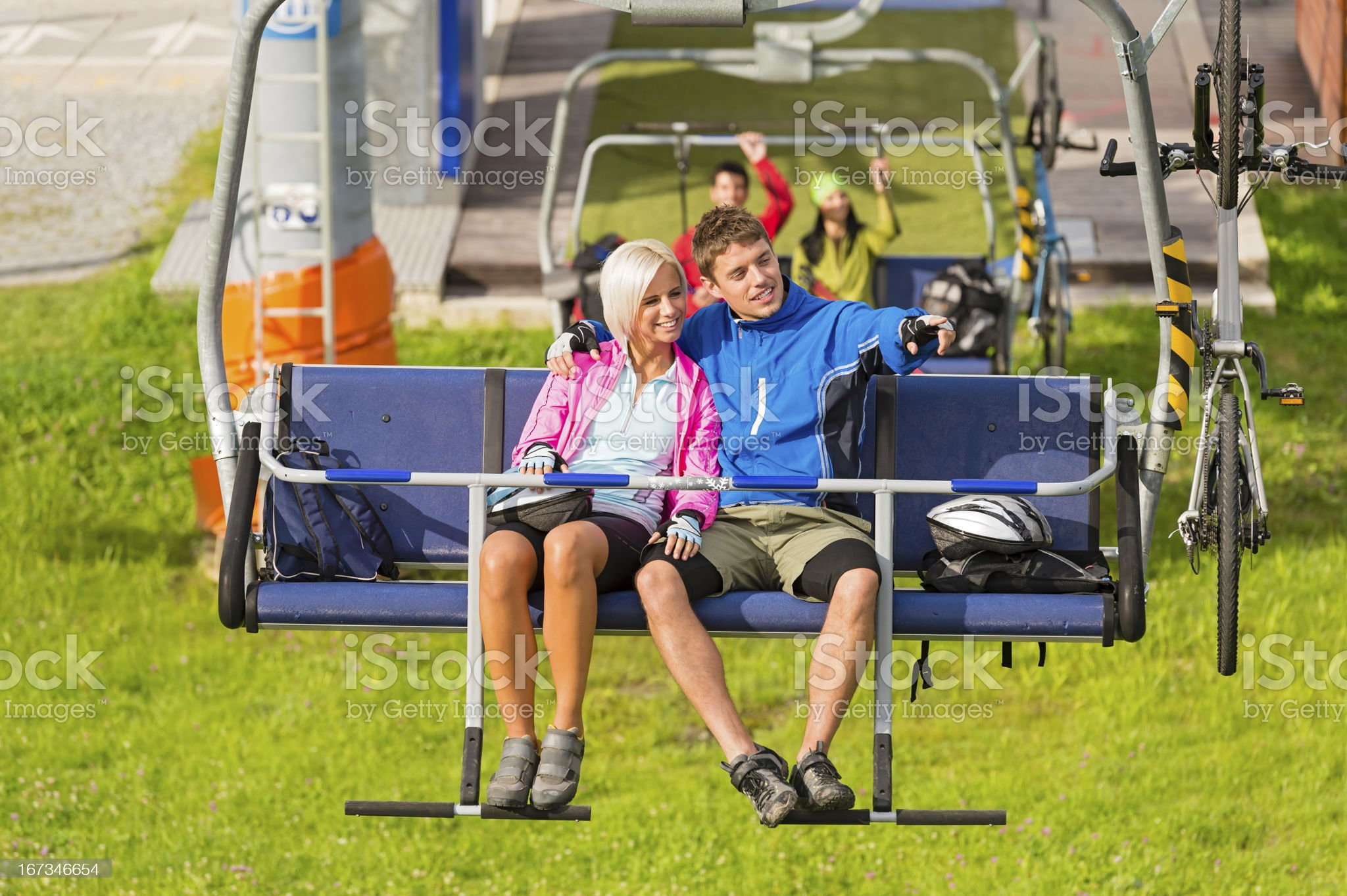 Couple on chair lift enjoying landscape royalty-free stock photo