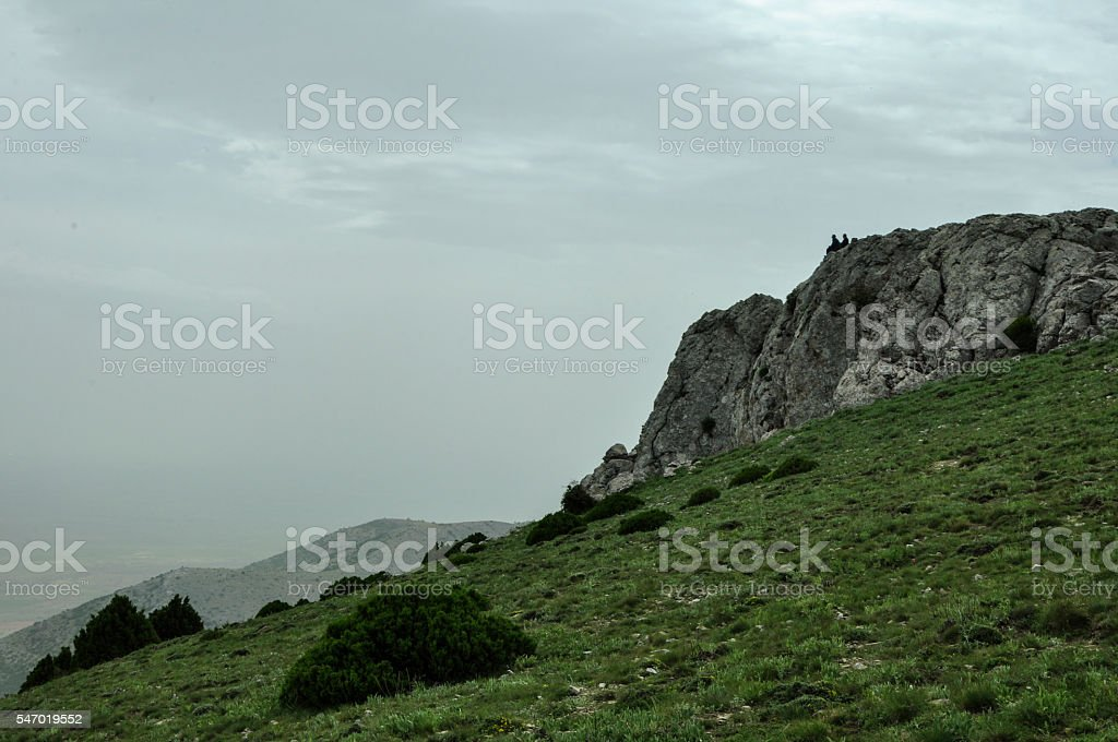 Two people in the cliffs. royalty-free stock photo