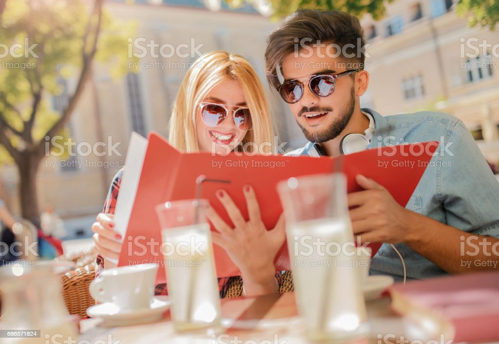 Couple on coffee break. Young students are preparing for seminar. Education, relationships, love concept stock photo