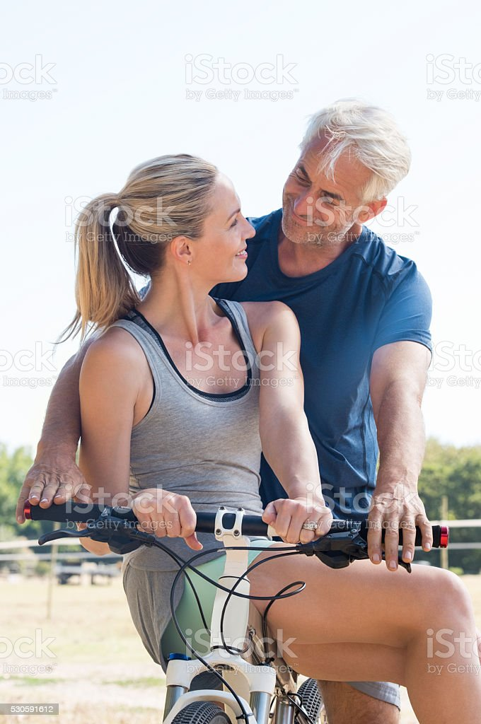 Couple on cycle ride stock photo