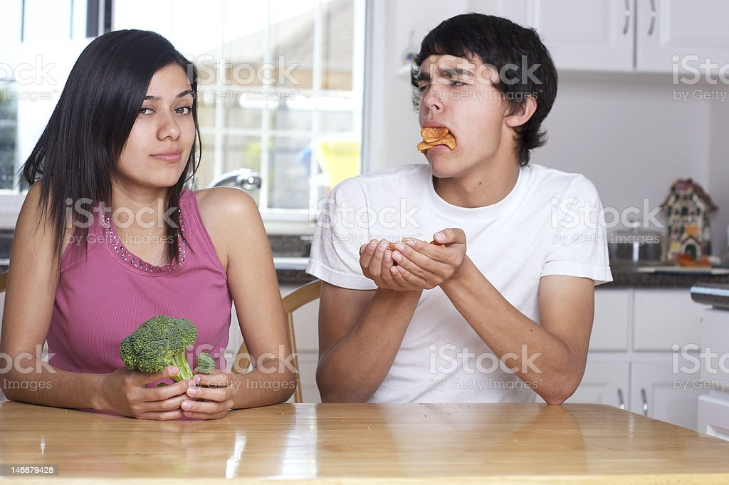 Couple on different diets stock photo