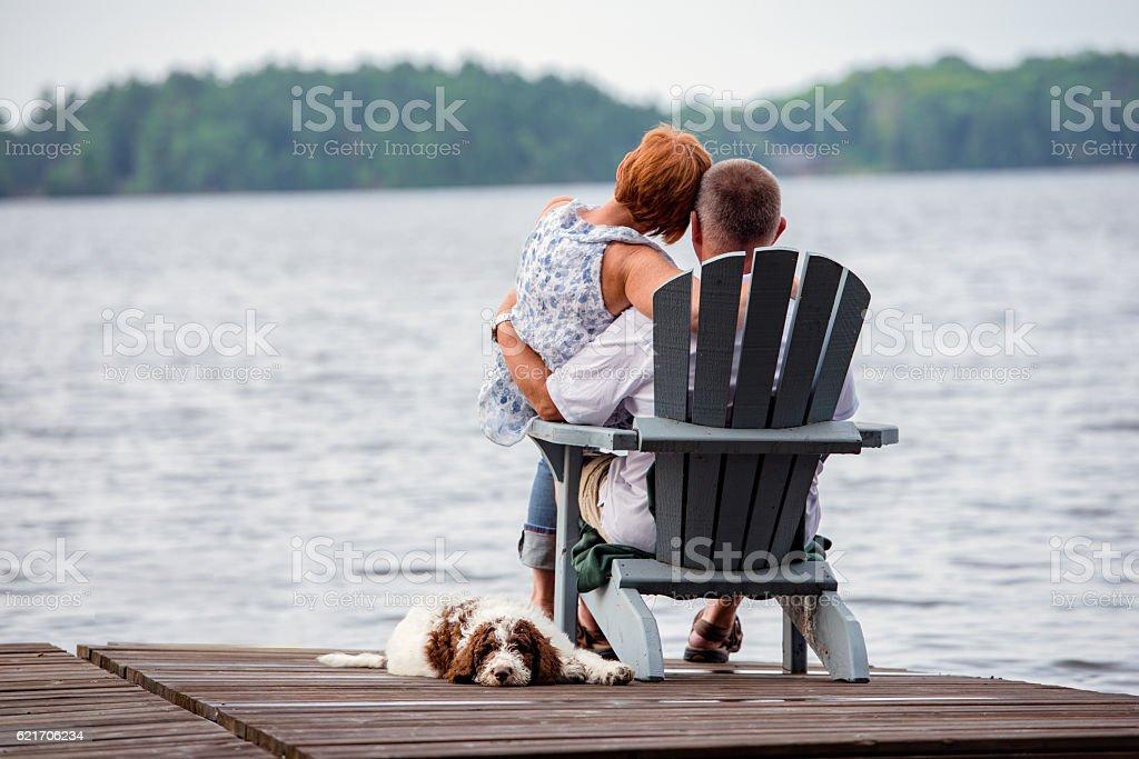 Couple on Dock with Dog stock photo