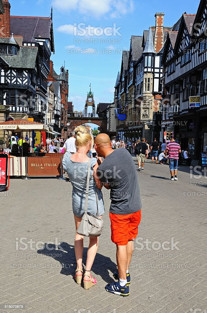 Couple on Eastgate Street, Chester. stock photo