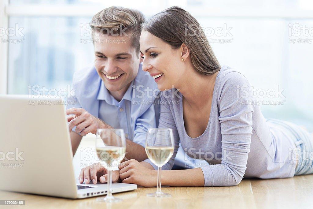 Couple on floor using laptop royalty-free stock photo