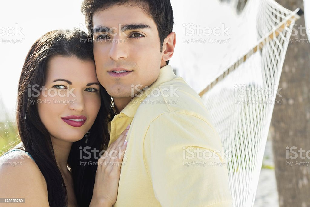Couple On Hammock Looking Away At Park. royalty-free stock photo