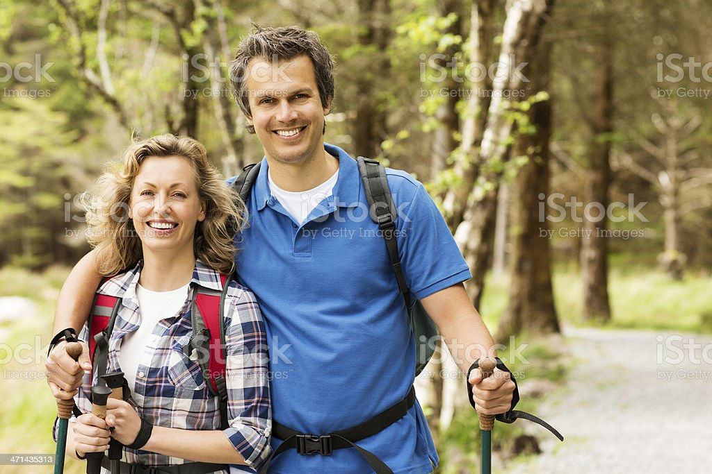 Couple On Hike With Trekking Poles royalty-free stock photo