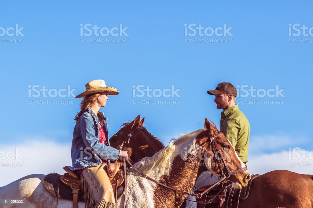Couple On Horseback Closeup stock photo