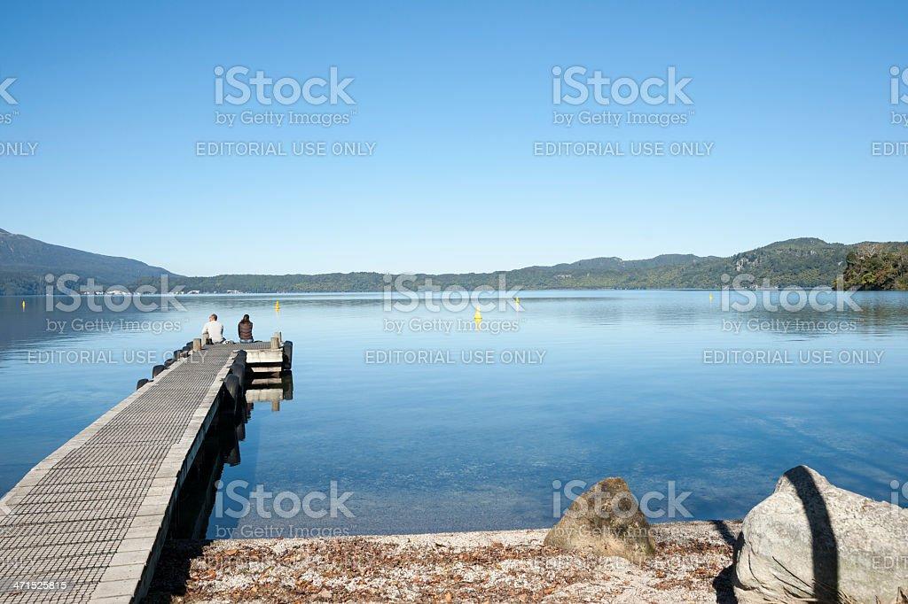Couple on jetty. stock photo