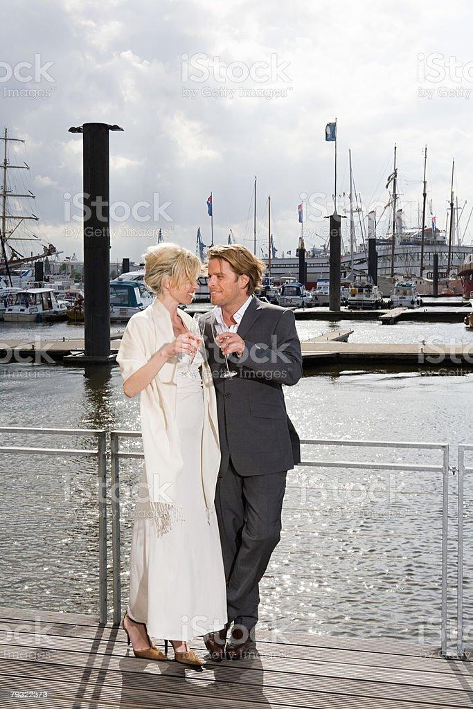 Couple on jetty royalty-free stock photo