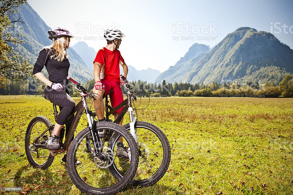 Couple on mountain bikes stock photo