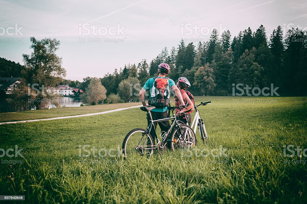 Couple on mountain bikes stock photo