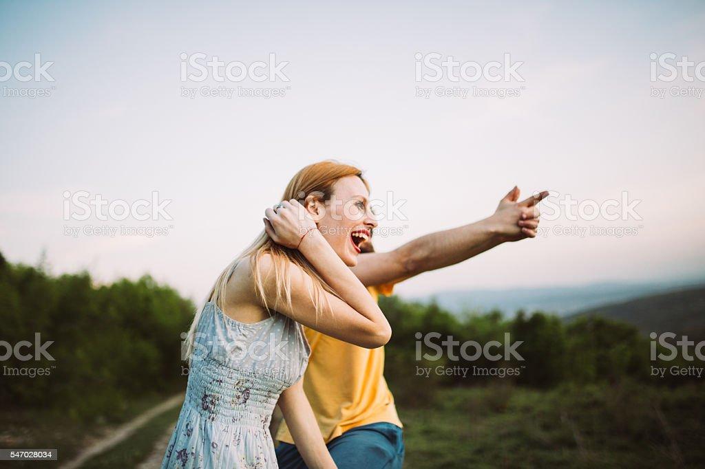 Couple on mountain field stock photo