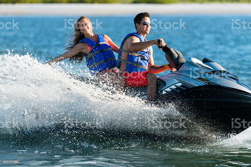Couple on Personal Water Craft stock photo