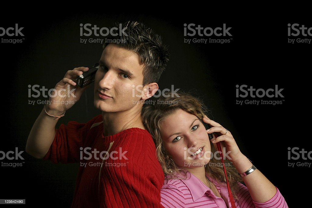 Couple on phones royalty-free stock photo
