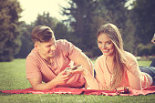Couple on picnic date outdoor.