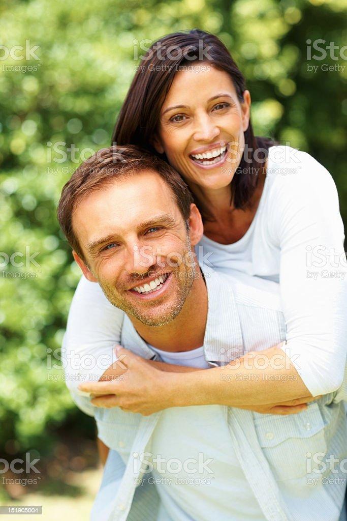Couple on piggyback ride royalty-free stock photo