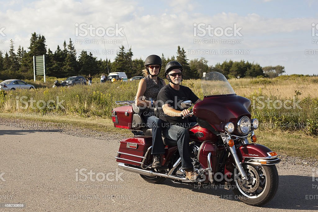 Couple on Red Harley stock photo
