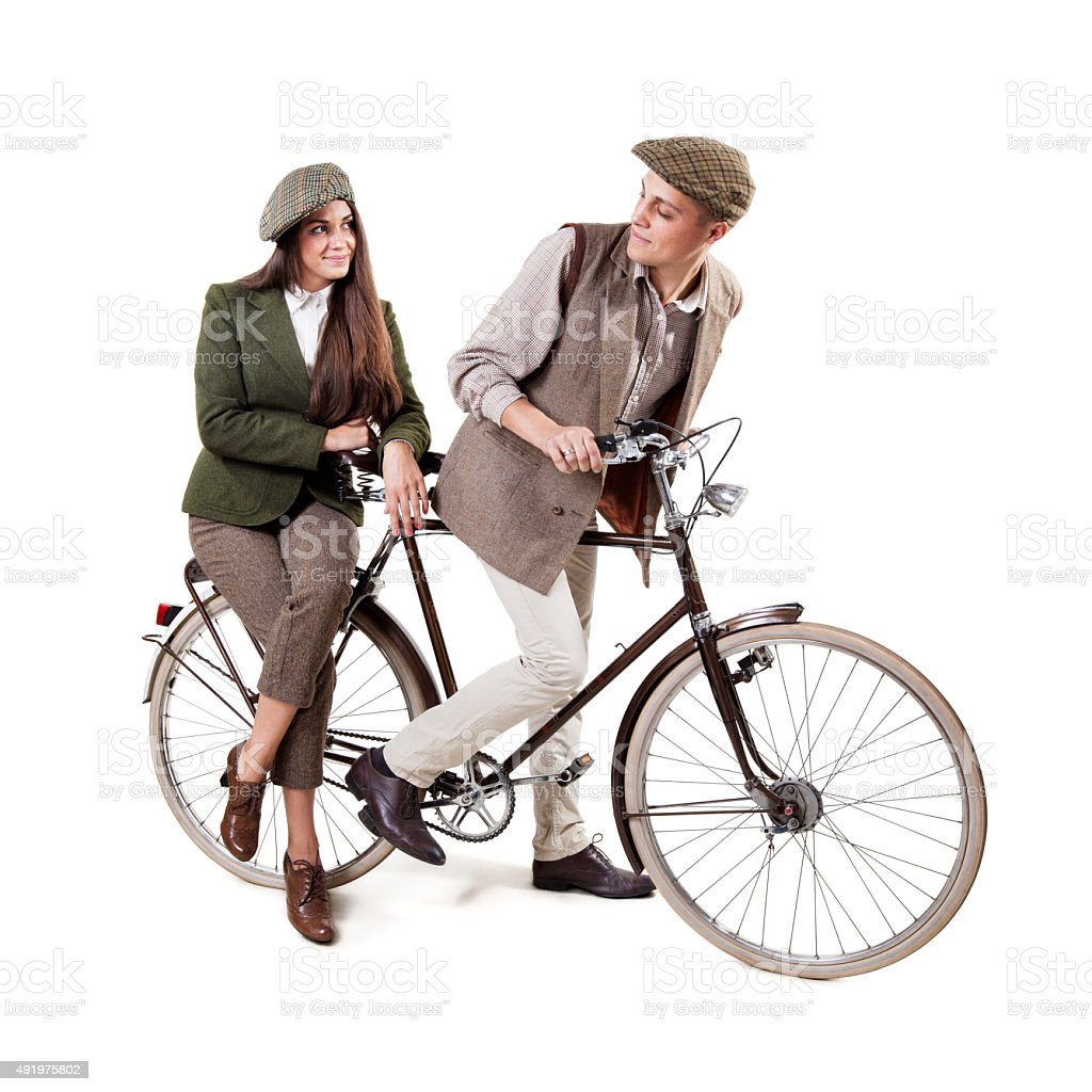 Couple on retro bike stock photo