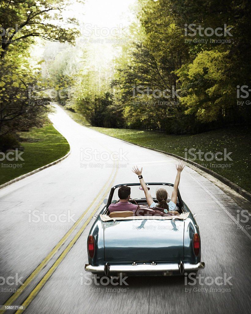 Couple on Roadtrip in Vintage Convertible Car stock photo