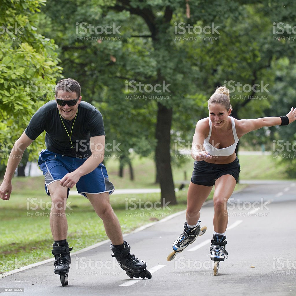 Couple on roller blades royalty-free stock photo