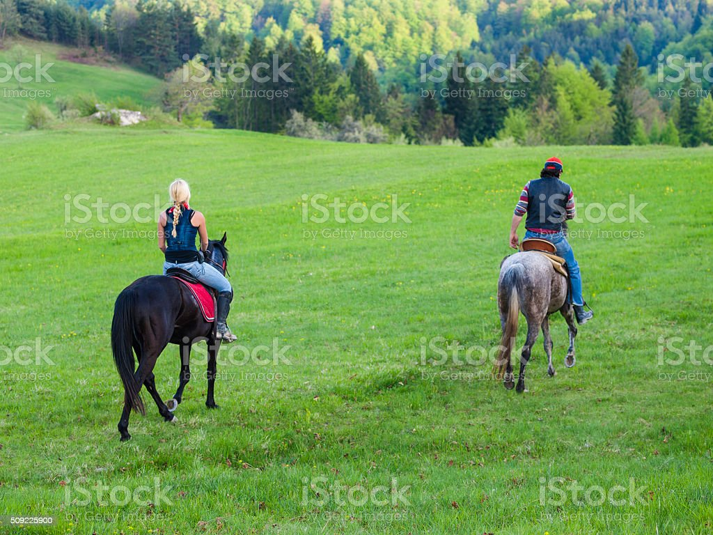 Couple on Rural country horseback riding stock photo