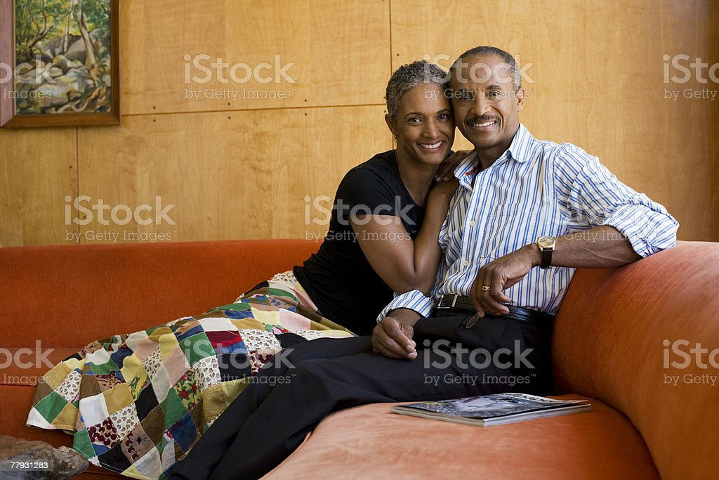 Couple on sofa in modern home royalty-free stock photo