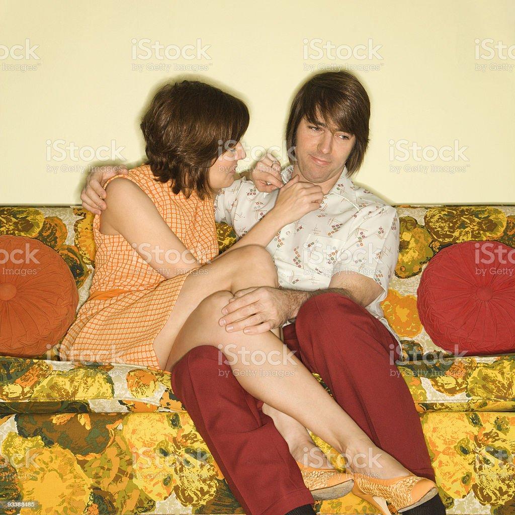 Couple on sofa. stock photo