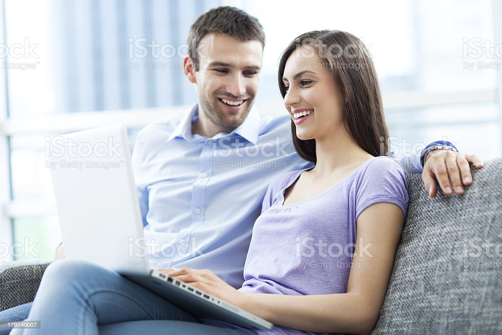 Couple on sofa with laptop royalty-free stock photo