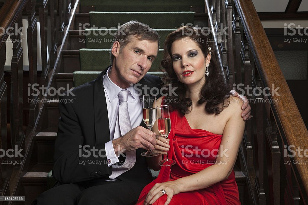 Couple on staircase with Champagne stock photo