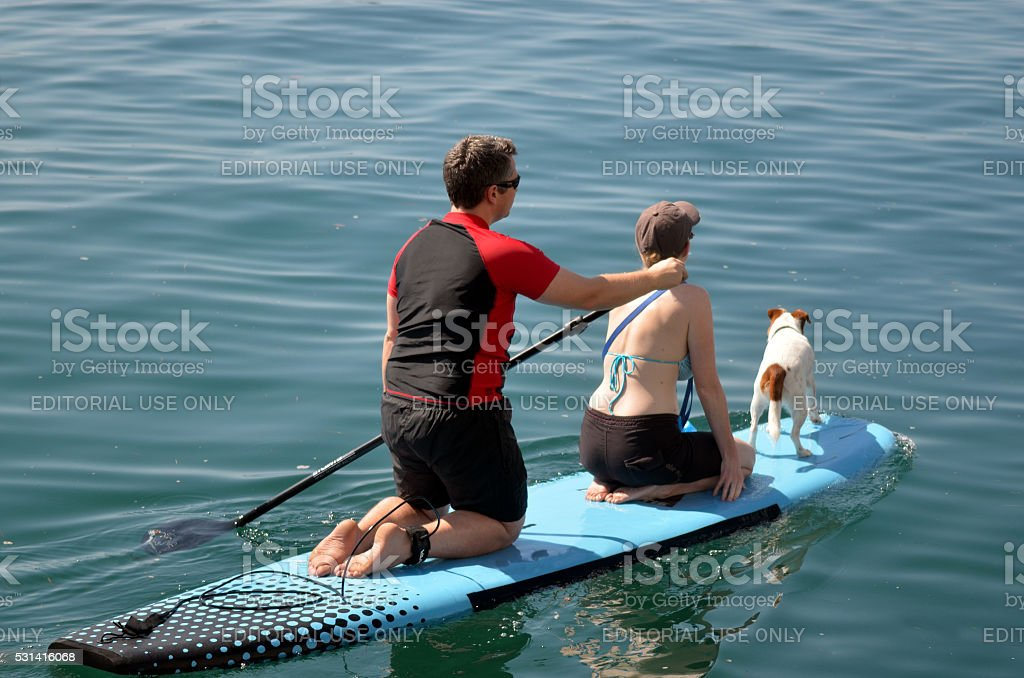 Couple on stand up paddling stock photo