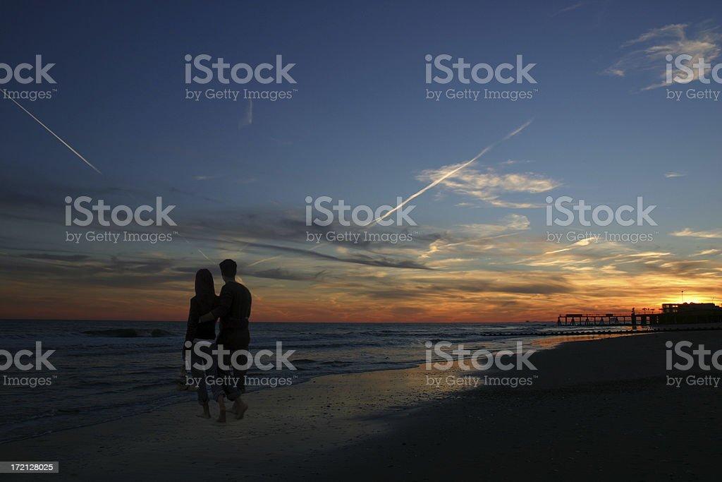 Couple on Sunset Beach royalty-free stock photo