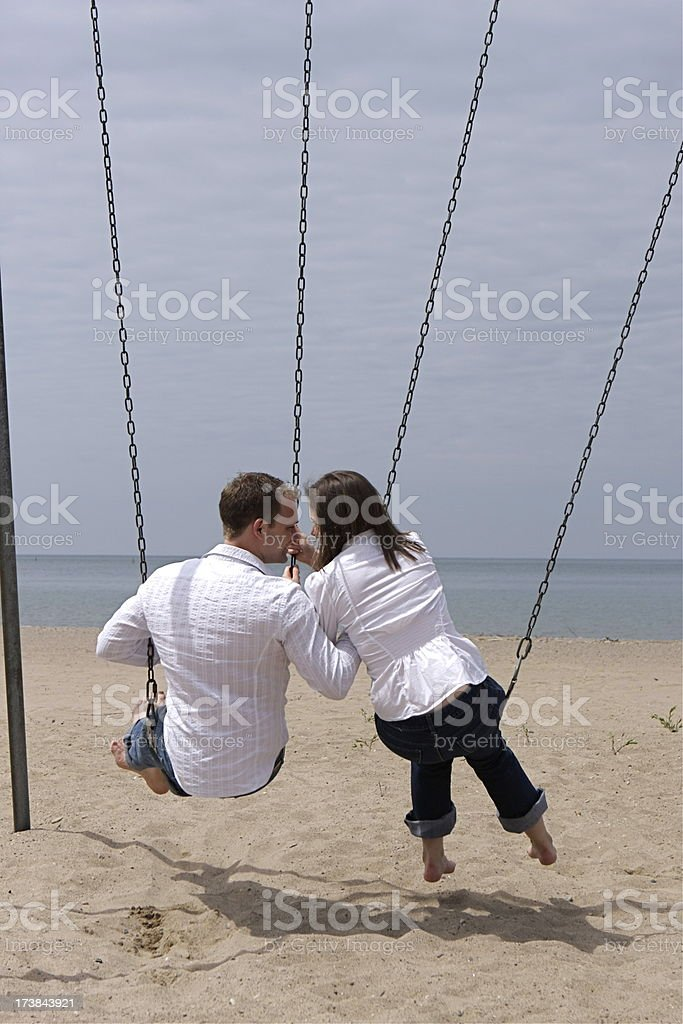Couple on Swings royalty-free stock photo