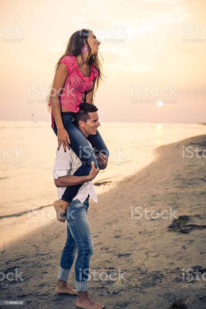 Couple on the beach at Sunset royalty-free stock photo