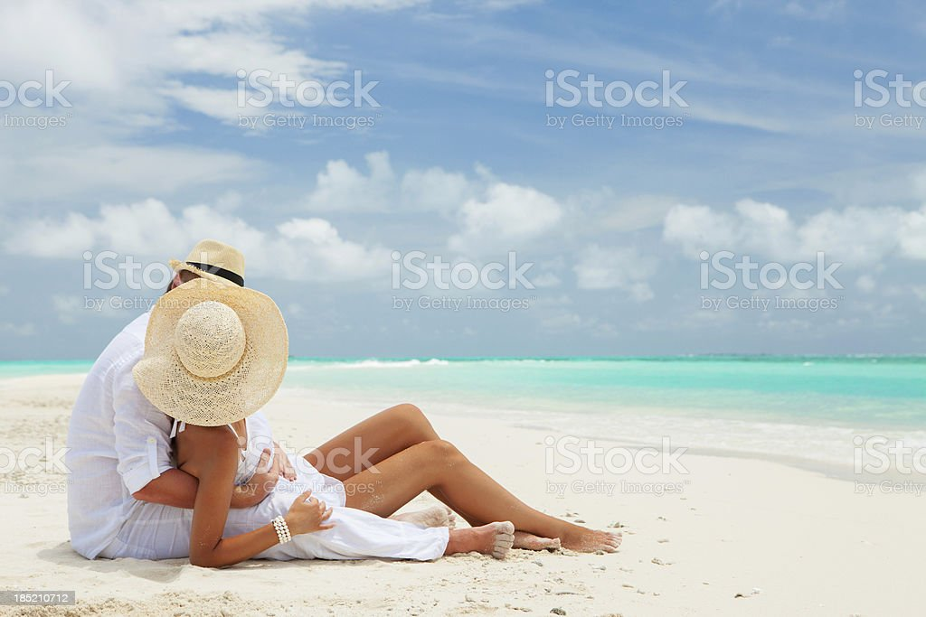 Couple on the beach of sea stock photo