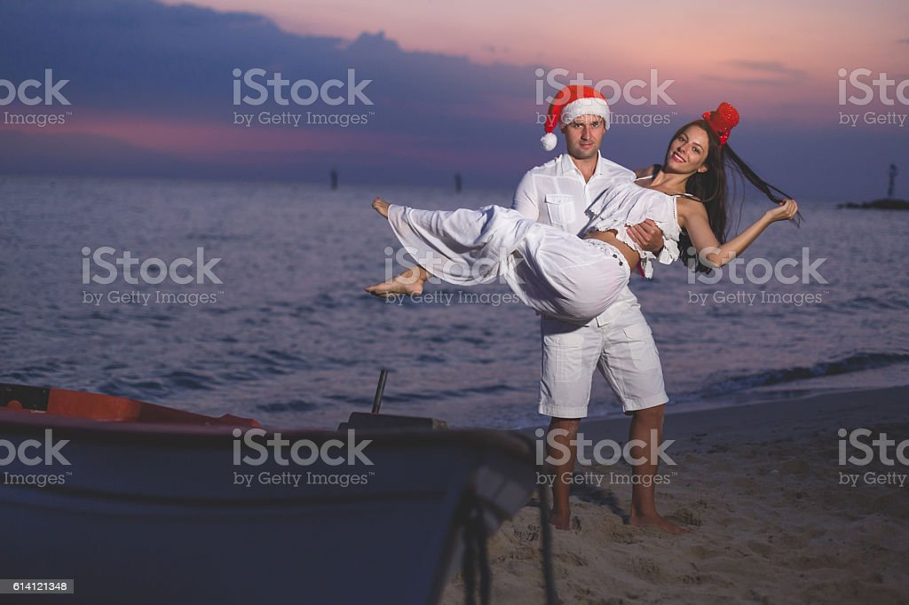 couple on the beach on new years eve stock photo