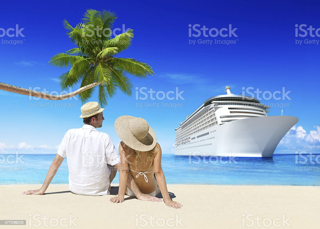 Couple on the Beach with Cruise Ship stock photo
