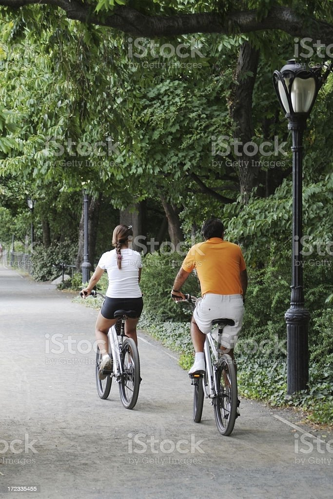 Couple on the bicycles in New York Central park royalty-free stock photo