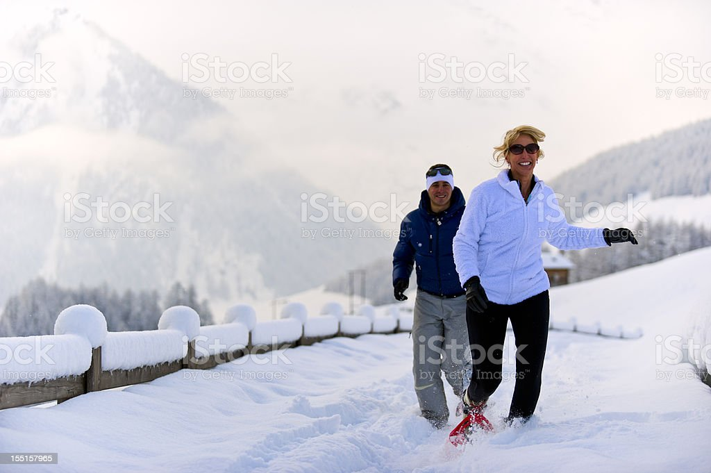Couple on the snow royalty-free stock photo