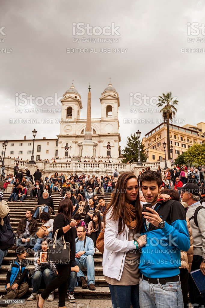 Couple on the Spanish Steps at Trinita dei Monti stock photo