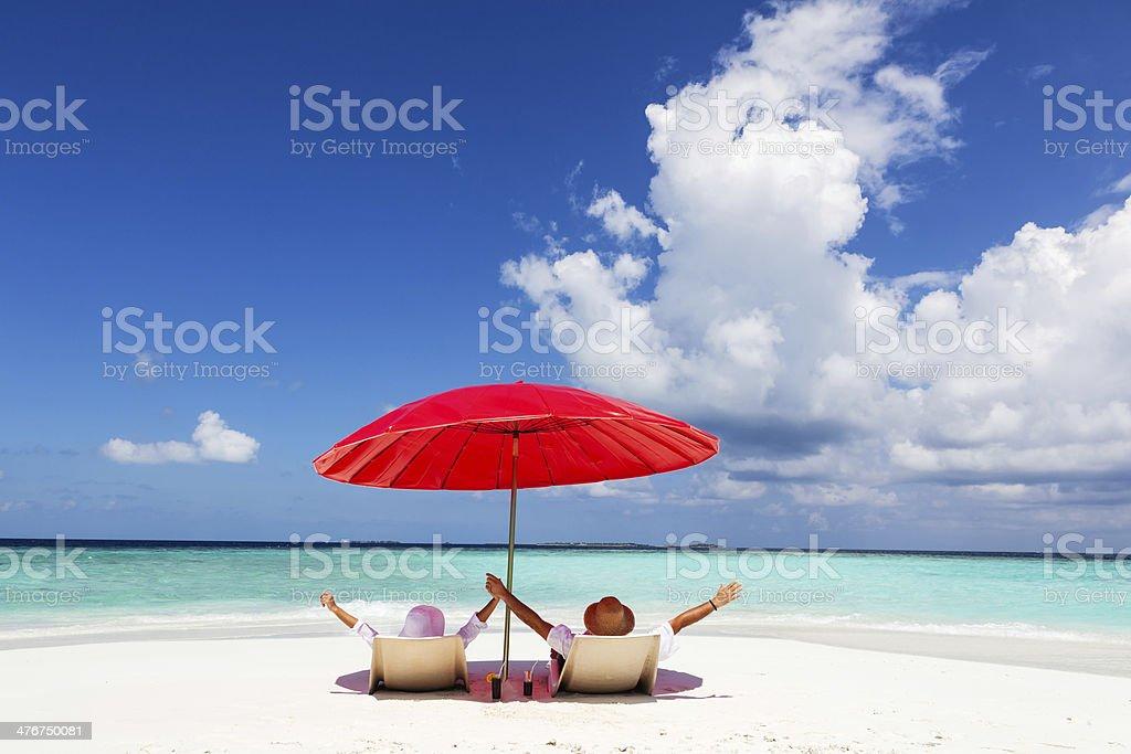 Couple On The Tropical Beach stock photo