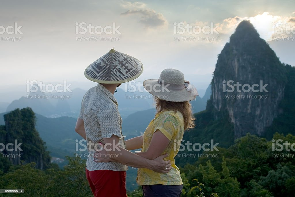 Couple on top of the mountain royalty-free stock photo